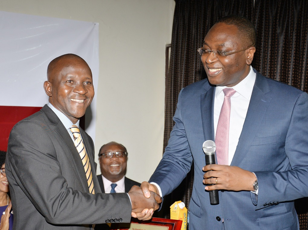 The Chairman Board of Trustees KEC, Mr. Charles Nwodo Jnr. with the beneficiary Mr. Obiora Obasi