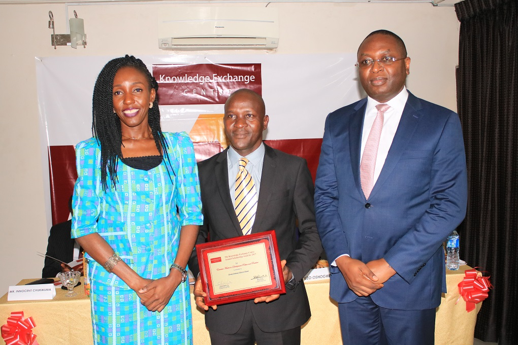 The beneficiary of the 2nd Annual Scholarship Award, Mr. Obiora Obasi with the Chairman Board of Trustees KEC
